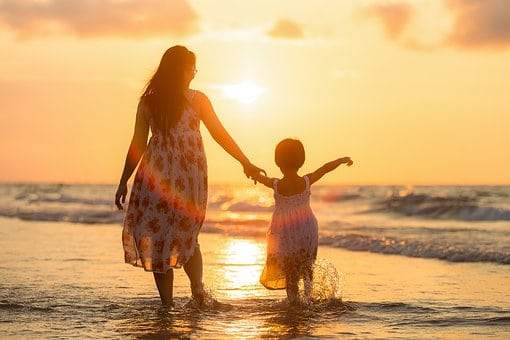 summer wished for earth moms mom and child on beach