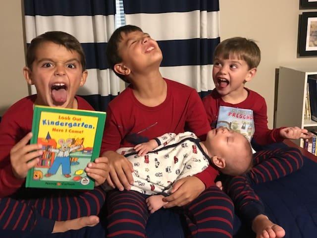 Boys reading bedtime story