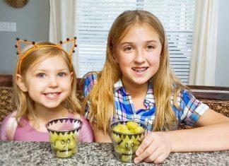 Two girls eating healthy Halloween treats
