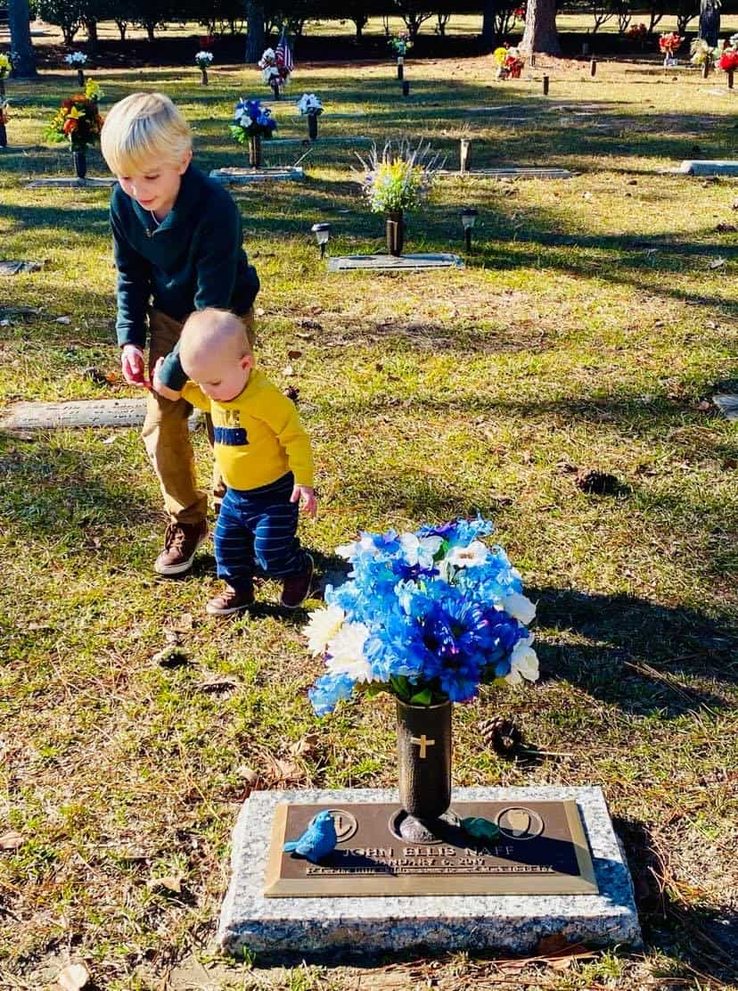 Boys at graveside