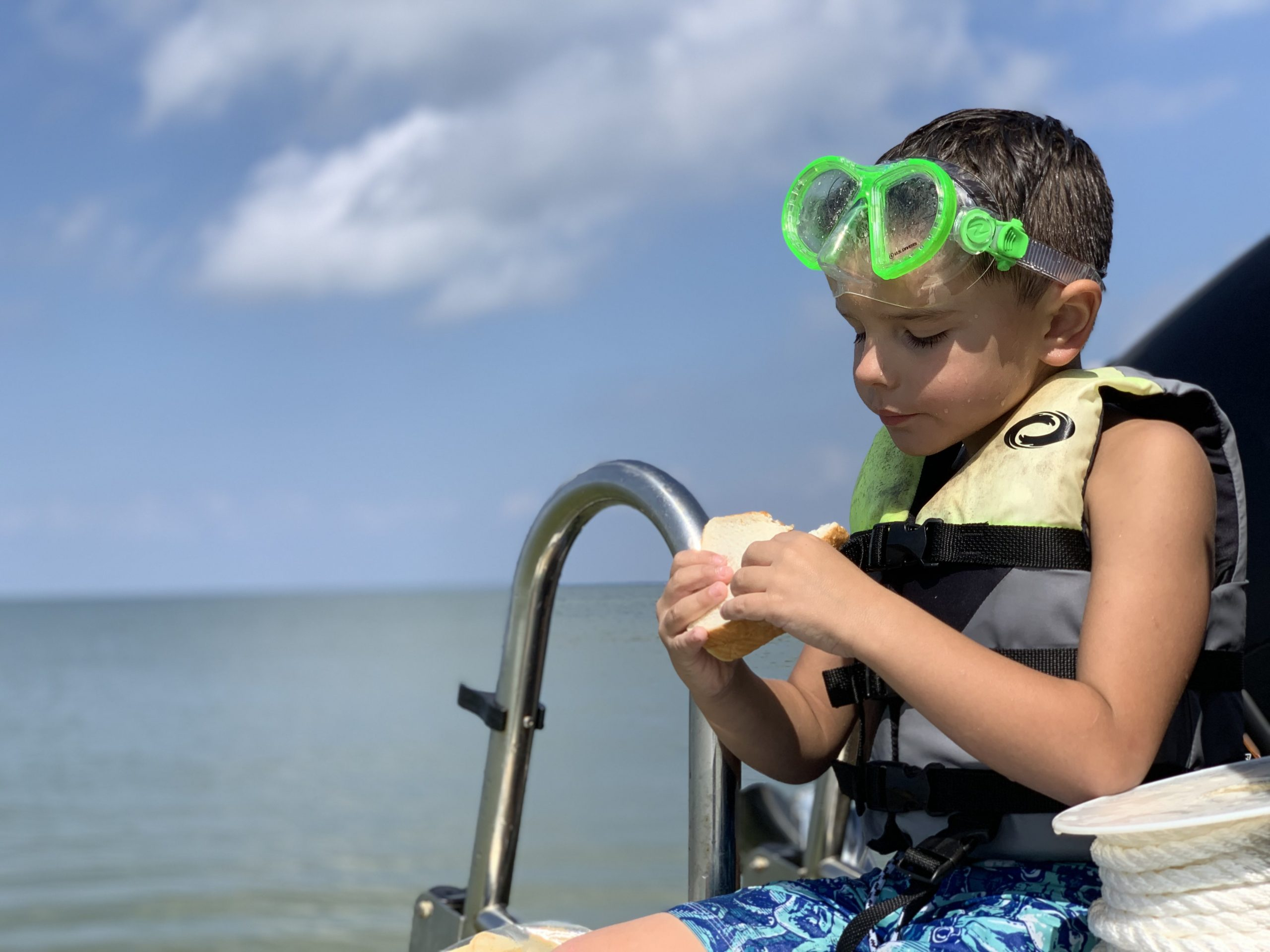 Child on a boat eating