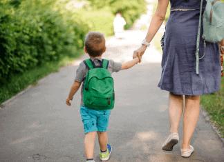 Mom walking son to preschool