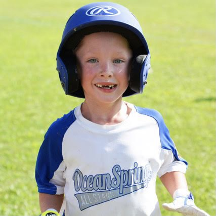 Boy running and playing baseball