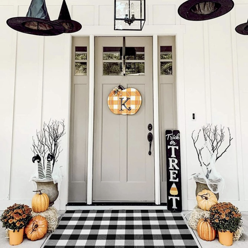 Front porch of house decorated for fall