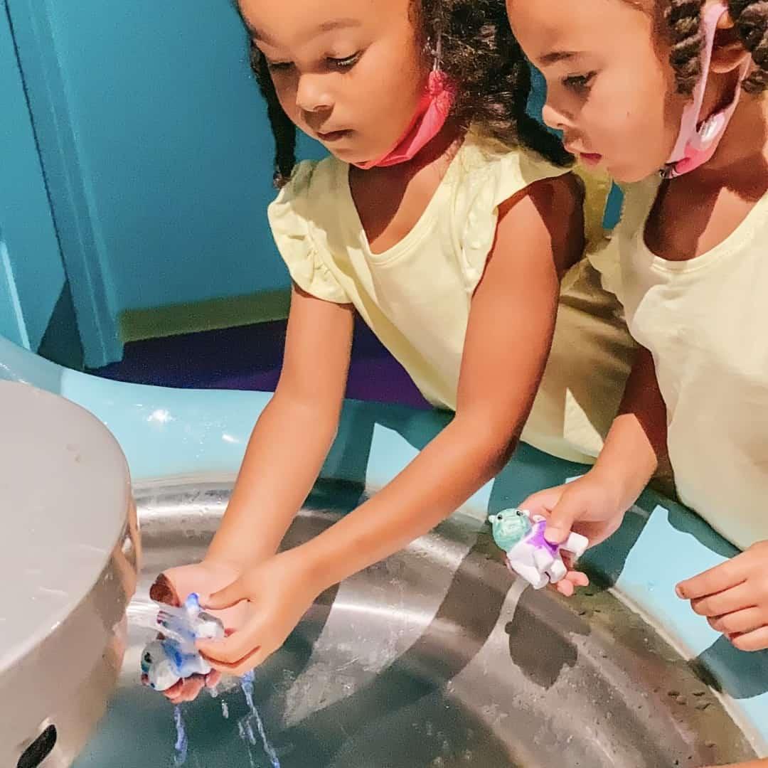Girls washing toy