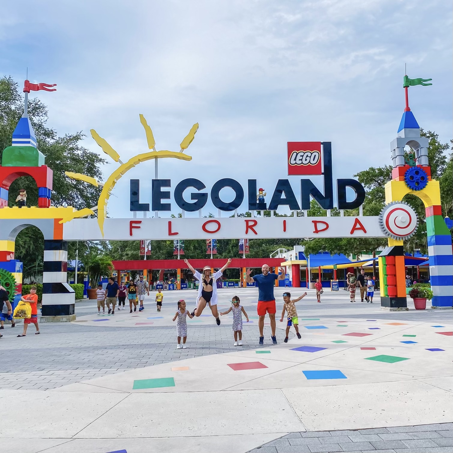 Family in front of Legoland Moms Love budget friendly trips to Orlando